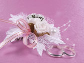 Weddings accessories are a buttonhole and rings — Stock Photo