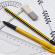 Stock Photo: Rulers with pencil on workbook page
