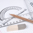 Rulers with pencil on the workbook page — Stock Photo