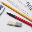 Stock Photo: Set of educatoins tools on workbook page