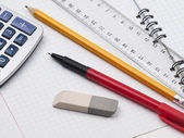 Set of educatoins tools on the workbook page — Stock Photo