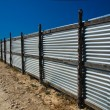Corrugated metal fence — 图库照片