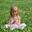 A little girl with flowers — Stock Photo #3603824