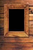 Frame op houten achtergrond — Stockfoto