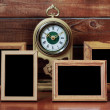 Old photo frames and antique clock — Stock Photo
