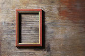 Empty frame on wooden background — Stock Photo