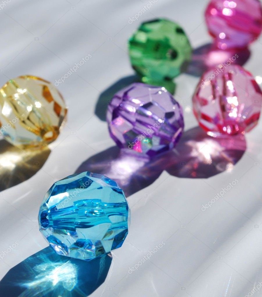 Multicoloured shine beads on white table  Stock Photo #3387405