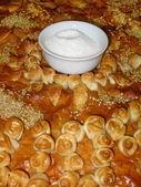 Saltcellar on bread — Stock Photo