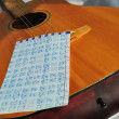 Guitar with notes - Stock Photo
