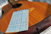 Guitar with notes — Stock Photo