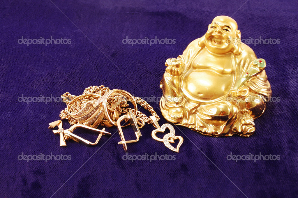 Feng Shui. God of wealth and gold ornaments on a blue velvet  Stockfoto #2854576