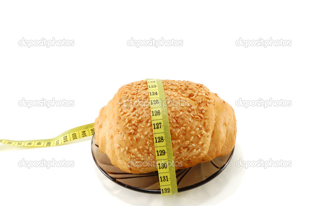 Bread with a centimeter tape isolated on a white background  Stock Photo #3252825