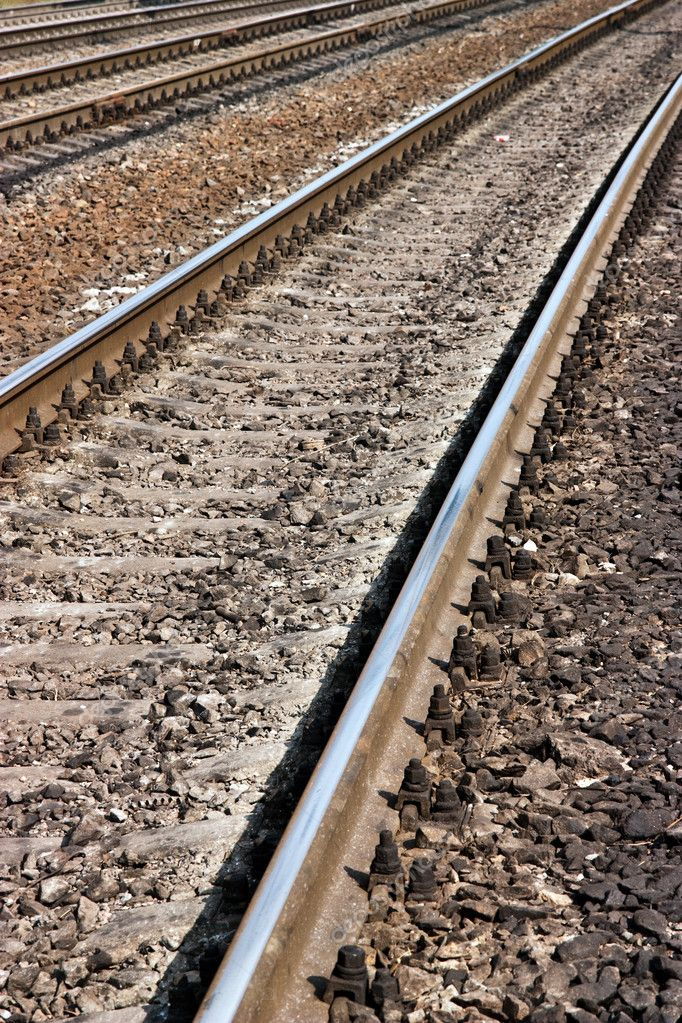 Closeup image of a railroad track goes into the distance  Stock Photo #3522281