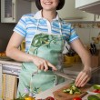 Woman cutting vegetables — Stock Photo #2771707