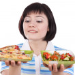 Woman makes choice of pizza and salad — Stock Photo