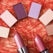 Eye shadow and lipsticks — Stock Photo