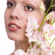 Pretty young woman portrait with orchid — Stock Photo #2771864