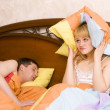 Woman awaking by her husband snoring — Stockfoto