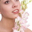 Pretty young woman portrait with orchid — Stock Photo