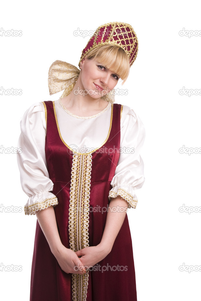 Girl standing in Russian traditional costume. Woman is wearing sarafan and kokoshnik . The girl in red old russian dress. Isolated on white. — Stock Photo #2964643