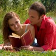 Couple reading and relaxing at the — Stockfoto