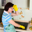 Smiling woman cleaning cooker — Стоковое фото #3089243