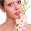 Woman portrait with orchid — Stock Photo