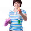 Woman holding wIndow cleaner and a rag. — Stock Photo