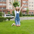 Stock Photo: Girl is jumping