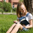 Student studying on the grass — Stock Photo
