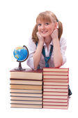 Schoolgirl with the stack of book and globe — Stock Photo