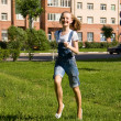 Foto Stock: Girl is running.Summer joy