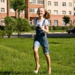 Stock Photo: Girl is running.Summer joy