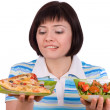 Woman makes choice of pizza and healthy salad — ストック写真