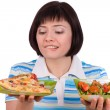 Woman makes choice of pizza and healthy salad — Stok fotoğraf