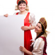 Women in Russian traditional costume with billboard. — Stock Photo #3322601