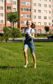 Girl is running.Summer joy — Stockfoto