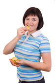 Young woman eating potato chips. — Foto de Stock