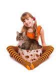Little girl wearing orange dress is sitting — Stockfoto