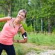Woman do exercises outdoor. — Stock Photo