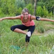 Woman do exercises outdoor. — Стоковое фото