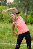 Woman do exercises outdoor. — Stock Photo