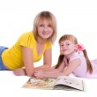 Mother and daughter with book — Stock Photo