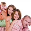 Happy family. Mother, father and two daughters — Stock Photo