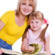 Stock Photo: Mother and daughter with book