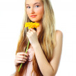 Young woman with a flower — Stock Photo #2810064