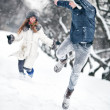 Young couple playing outdoors — Stockfoto