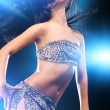 Young sexy dancing woman - Stock Photo