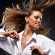 Foto Stock: Woman with fluttering hair