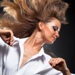 Stock Photo: Woman with fluttering hair